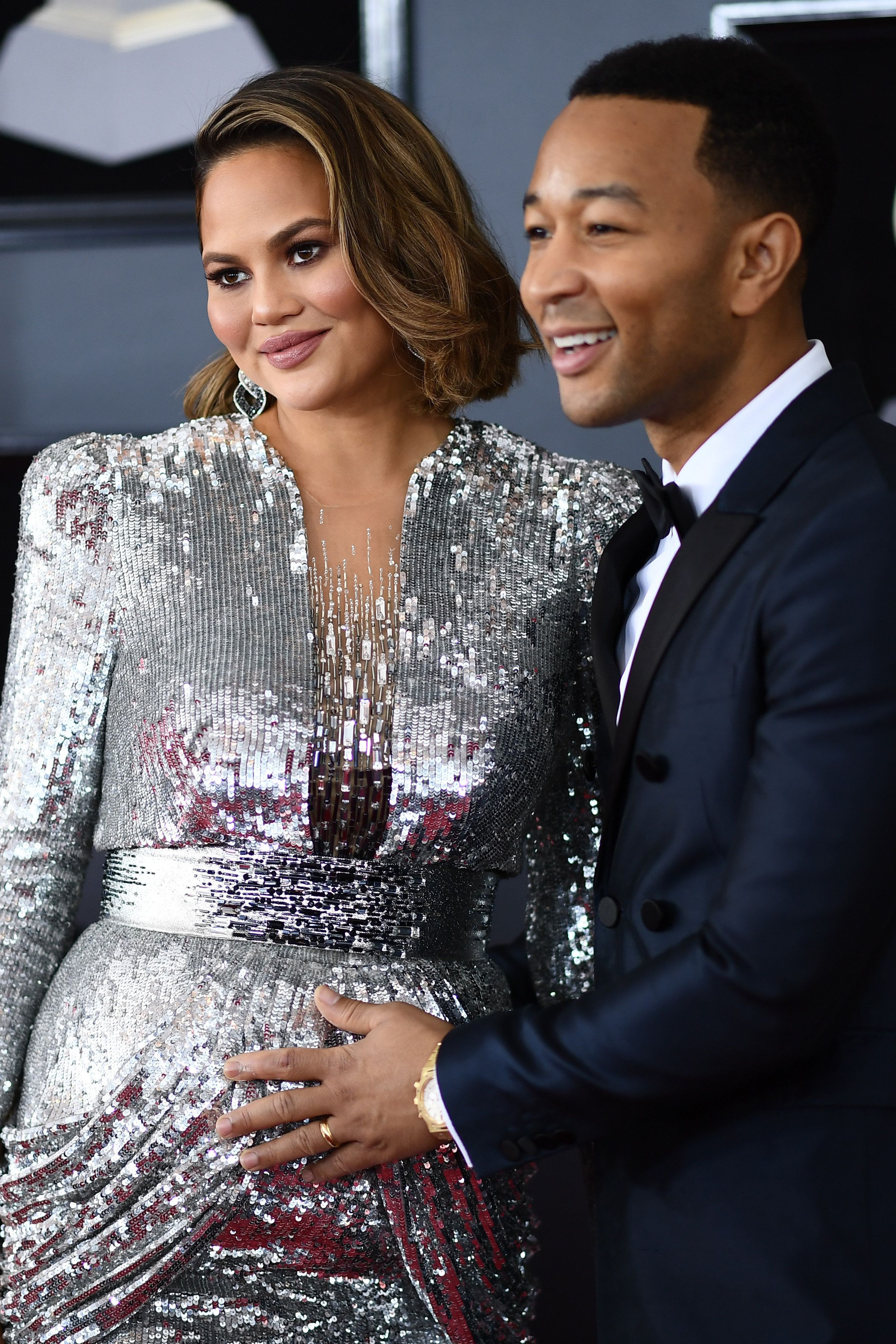 John Legend (R) and Chrissy Teigen arrive for the 60th Grammy Awards on January 28, 2018, in New York.  / AFP PHOTO / Jewel SAMAD        (Photo credit should read JEWEL SAMAD/AFP/Getty Images)