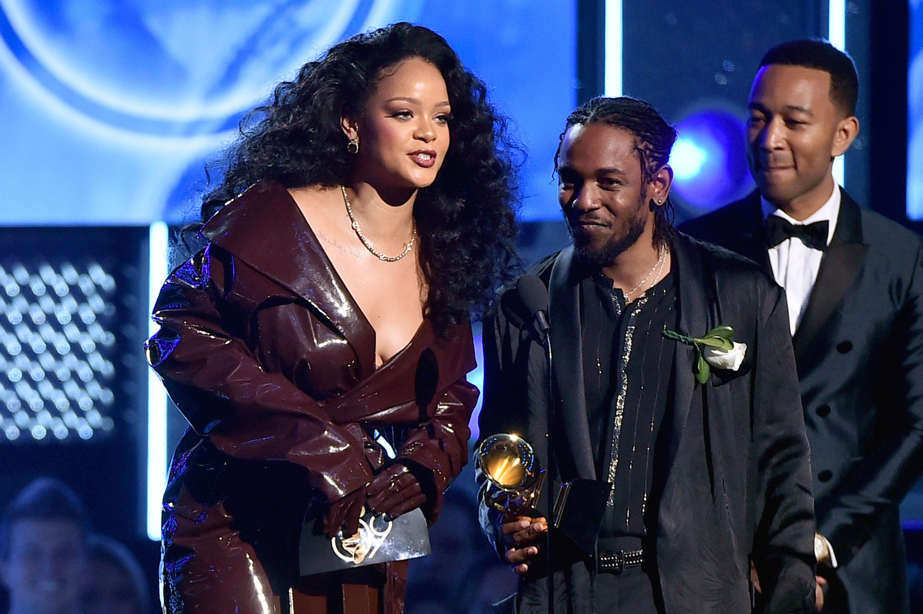 NEW YORK, NY - JANUARY 28:  (L-R) Recording artists Rihanna and Kendrick Lamar accept the Best Rap/Sung Performance award for 'Loyalty' from recording artist John Legend onstage during the 60th Annual GRAMMY Awards at Madison Square Garden on January 28, 2018 in New York City.  (Photo by Theo Wargo/WireImage)