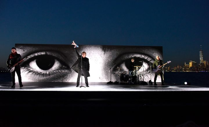 U2 performs on the Hudson River.