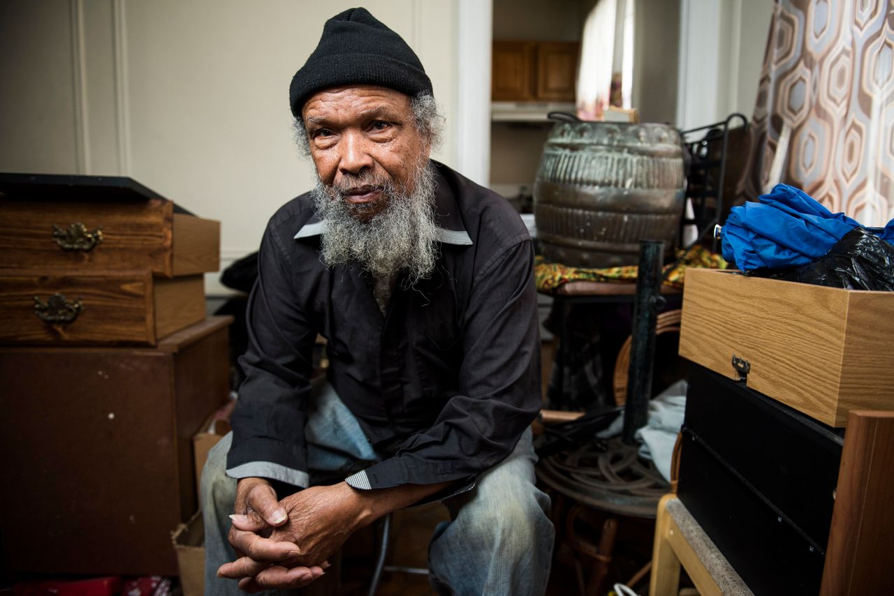 Brooklyn resident Winston Stiell sits among his possessions on Jan. 8, 2018. Stiell and his wife Violet were evicted from their Prospect Lefferts Gardens apartment last year.
