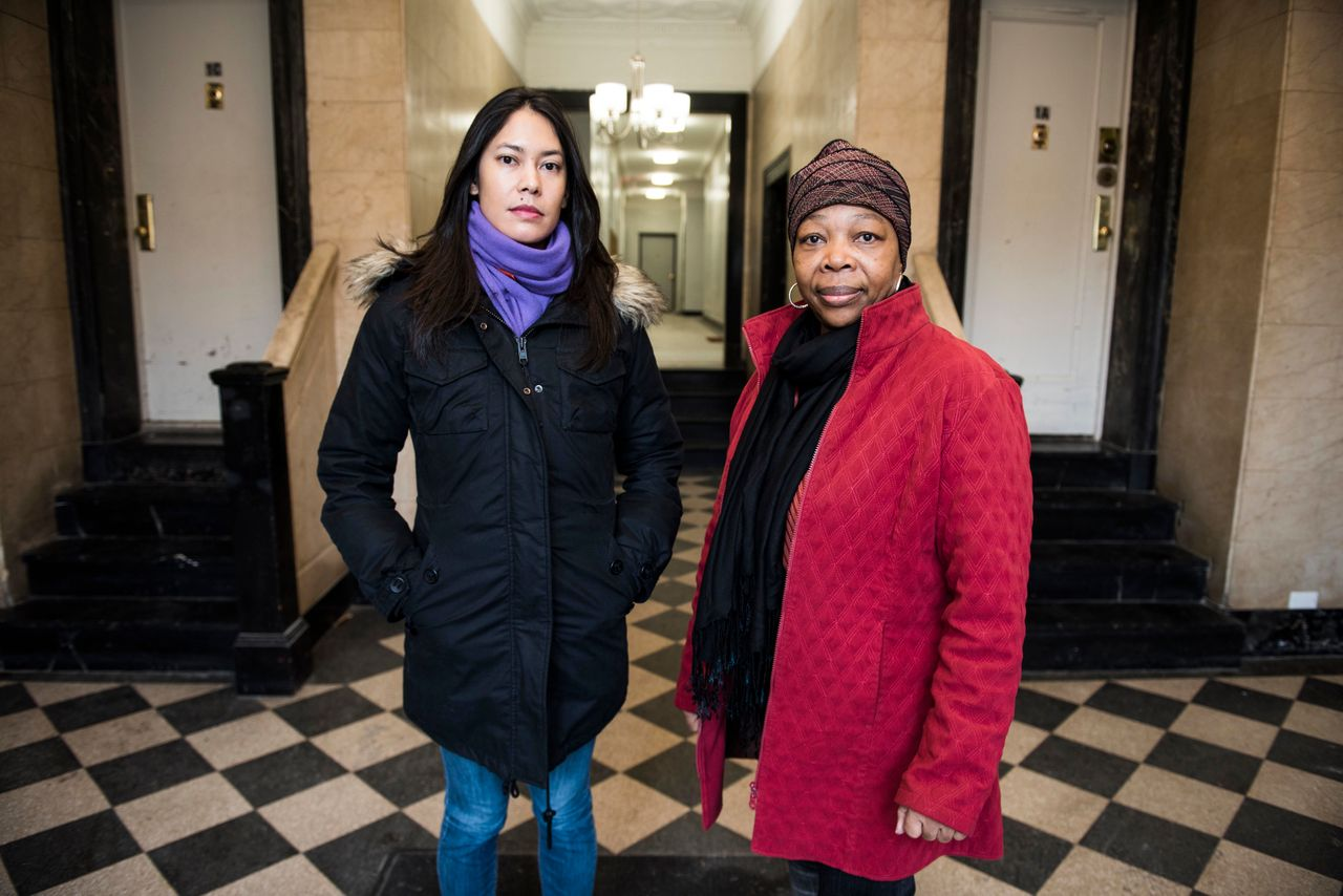 Dara Soukamneuth and Clentine Fenner inside the lobby of their apartment building in Crown Heights, Brooklyn, on Jan. 13, 2018. The two women are members of the building's tenant union, which advocates for safe and healthy living conditions.