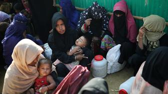 Rohingya refugee women wait outside of a medical center at Jamtoli camp in Cox's Bazar, Bangladesh, January 22, 2018. REUTERS/Mohammad Ponir Hossain