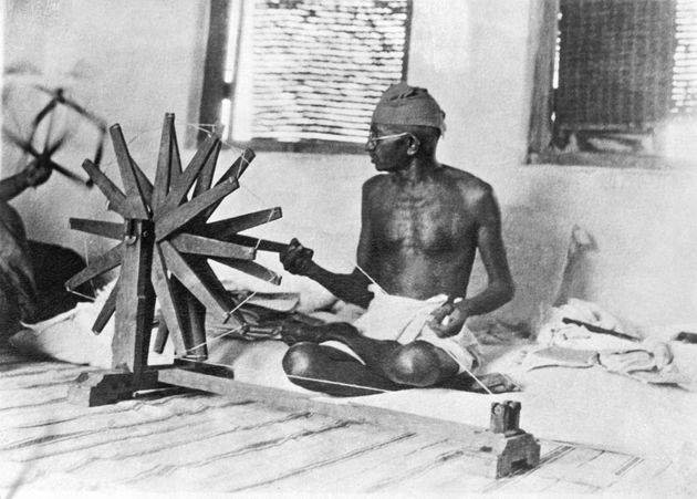 Gandhi making homespun cotton to boycott English merchandise and boost Indian economic