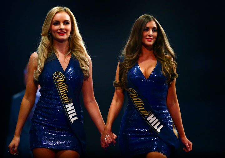 "Two ""walk-on girls"" at the World Darts Championships in December 2016."
