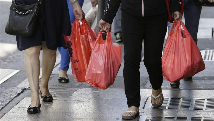 Women walk with plastic bags through Chinatown in San Francisco. Two years ago, California voters approved a statewide ban on