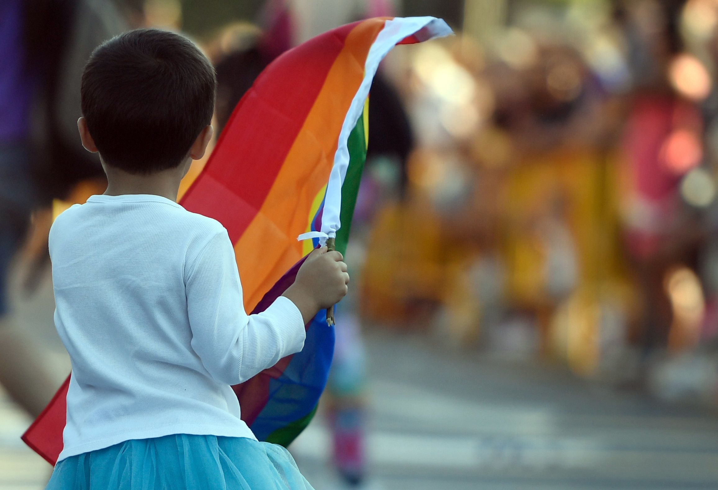 A child waves a rainbow flag during the WorldPride 2017 parade in Madrid on July 1, 2017. Revellers took to the rainbow streets of Madrid today in the world's biggest march for gay, lesbian, bisexual and transgender rights. Carried along by the slogan 'Viva la vida!' (Live life!), the parade of 52 floats started partying its way through the centre later afternoon in celebration of sexual diversity, under high security.    / AFP PHOTO / CURTO DE LA TORRE        (Photo credit should read CURTO DE LA TORRE/AFP/Getty Images)