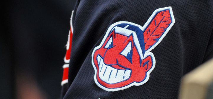 The controversial Chief Wahoo logo is seen on the sleeve of a Cleveland Indians player during a game in 2016.