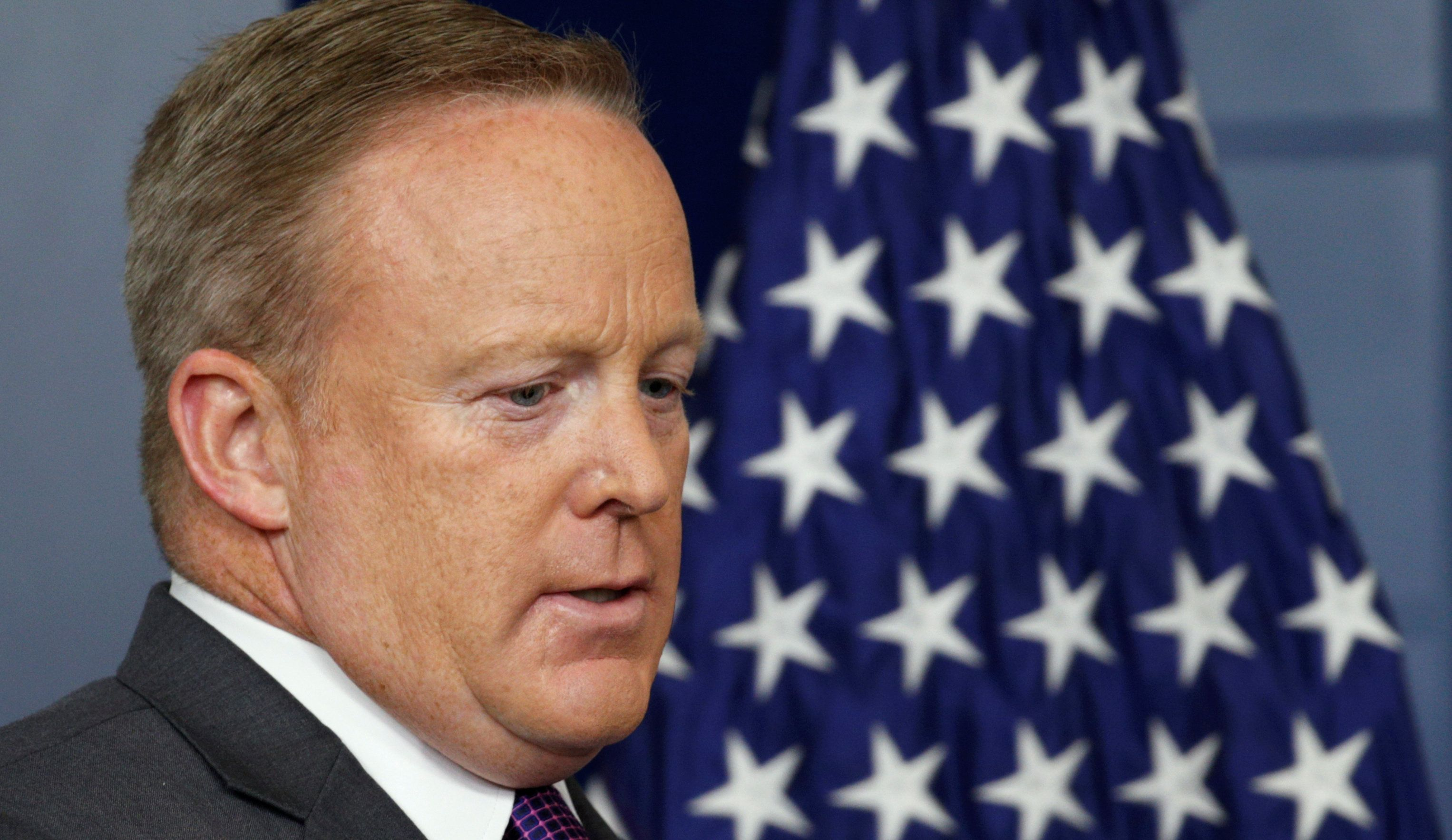 White House spokesman Sean Spicer arrives for a press briefing at the White House in Washington, U.S., July 17, 2017.  REUTERS/Kevin Lamarque
