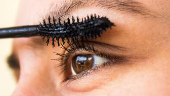 Female applying mascara, close up,horizontal composition. Image developed from Raw format.
