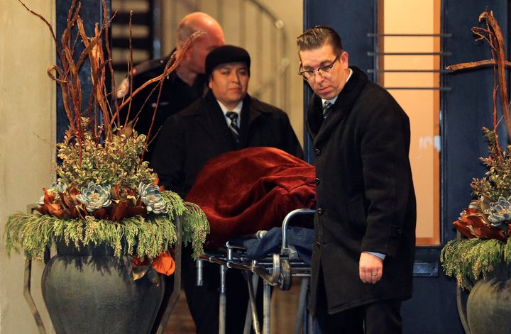 One of two bodies is removed from the home of billionaire founder of Canadian pharmaceutical firm Apotex Inc.