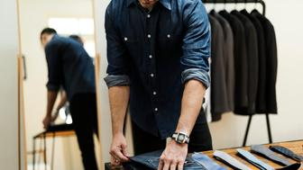 Man working in retail cloth shop