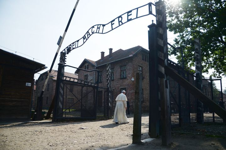 Pope Francis passes the main entrance of the former Nazi German Auschwitz-Birkenau death camp on July 29, 2016, as part