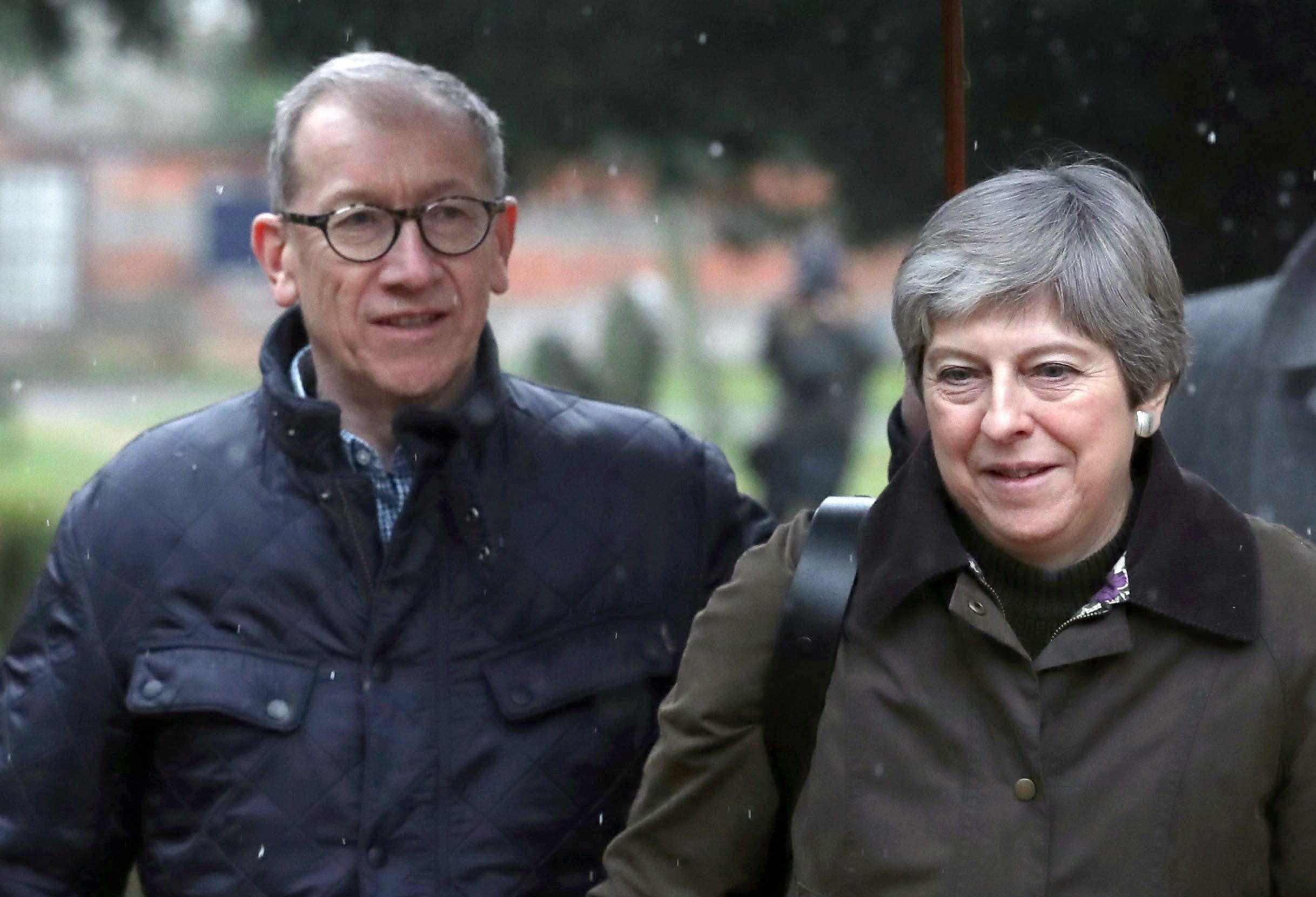 PA Wire  PA Images                   Philip May and the Prime Minister