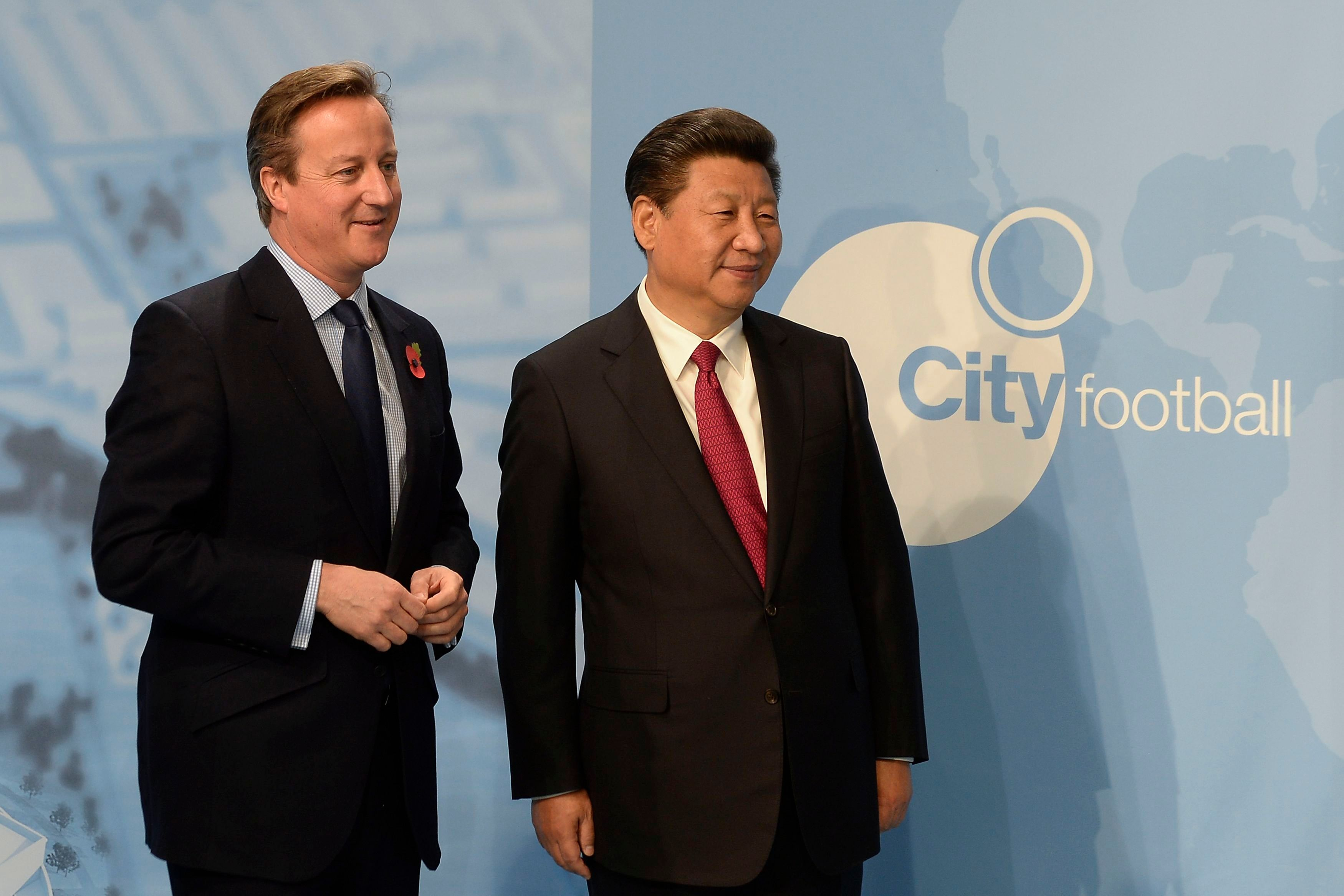 David Cameron and the Chinese President at Manchester City's football academy