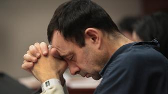 LANSING, MI - JANUARY 16:  Larry Nassar listens to victim impact statements prior to being sentenced after being accused of molesting about 100 girls while he was a physician for USA Gymnastics and Michigan State University, where he had his sports-medicine practice on January 16, 2018 in Lansing, Michigan. Nassar has pleaded guilty in Ingham County, Michigan, to sexually assaulting seven girls, but the judge is allowing all his accusers to speak. Nassar is currently serving a 60-year sentence in federal prison for possession of child pornography.  (Photo by Scott Olson/Getty Images)