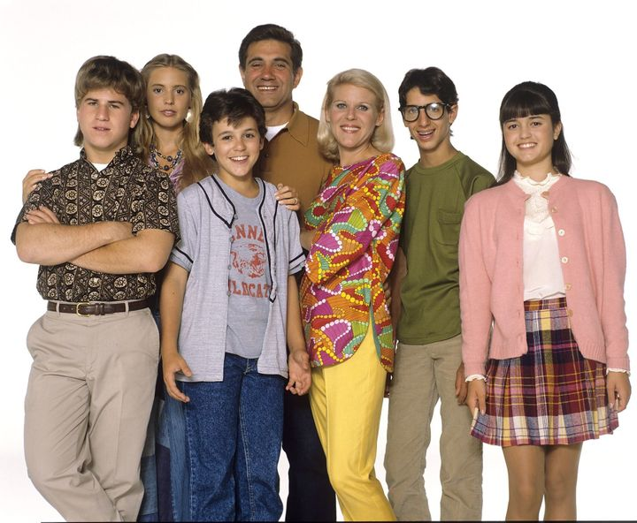 1990 cast photo of, from left, Jason Hervey, Olivia d'Abo, Fred Savage, Dan Lauria, Alley Mills, Josh Saviano, and Dani