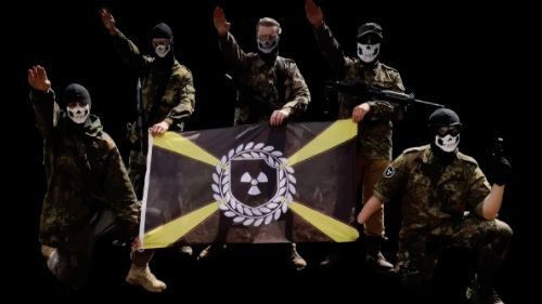 Members of the Atomwaffen Division, a violent neo-Nazi group, pose with their nuclear-themed flag.