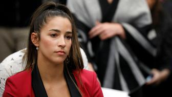 REFILE - CORRECTING IDENTITY OF ALY RAISMAN Victim and Olympic gold medalist Aly Raisman appears before speaking at the sentencing hearing for Larry Nassar, a former team USA Gymnastics doctor who pleaded guilty in November 2017 to sexual assault charges, in Lansing, Michigan, U.S., January 19, 2018. REUTERS/Brendan McDermid