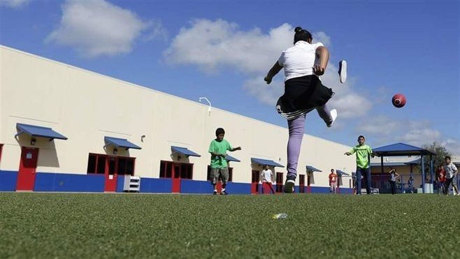 Children play in a Texas residential center for women and children detained at the Mexican border. The number of children fou
