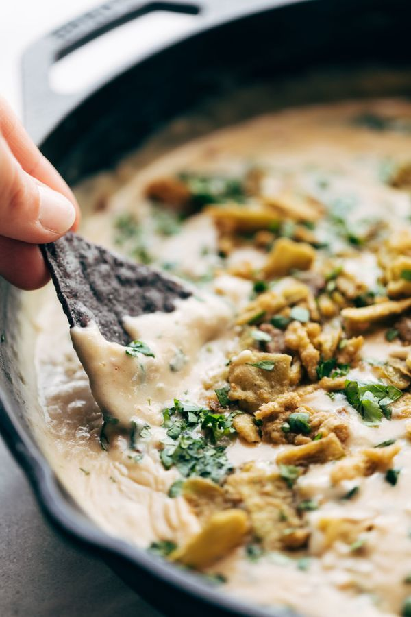 """<strong>Get the <a href=""""https://pinchofyum.com/spinach-queso"""" target=""""_blank"""">Spinach Queso </a>recipe from Pinch of Yum</st"""