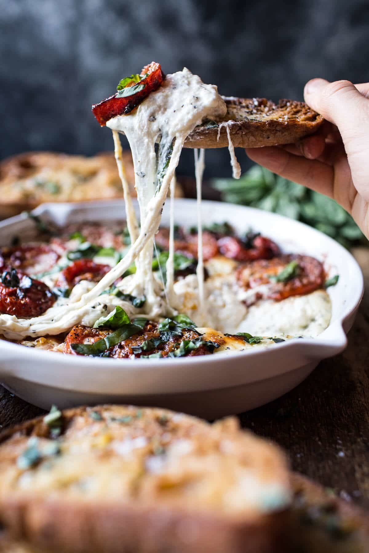 "<strong>Get the <a href=""https://www.halfbakedharvest.com/margherita-pizza-dip-burrata/"" target=""_blank"">Margherita Pizza Dip"