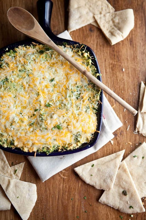 """<strong>Get the <a href=""""https://naturallyella.com/baked-hummus-and-spinach-dip/"""" target=""""_blank"""">Baked Hummus and Spinach Di"""