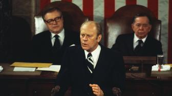 (Original Caption) Washington: President Ford delivers his state of the Union message at the Capitol 1/19. Listening in the rear are Vice President Nelson Rockefeller, left, and Speaker of the House Carl Albert.