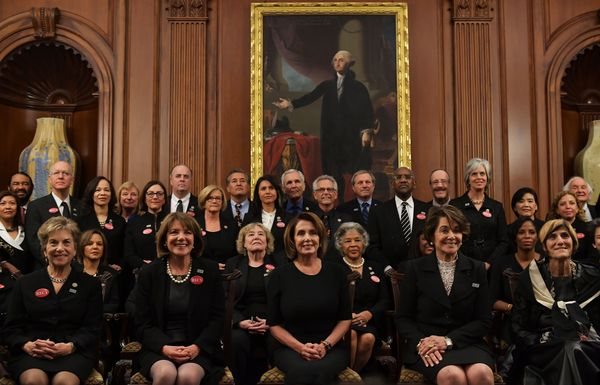 """House Minority Leader Nancy Pelosi (D-Calif.), center, poses with members of Congress wearing black in support of the """"Me Too"""