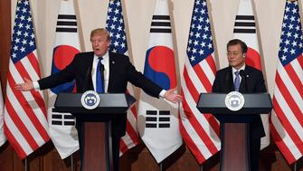 U.S. President Donald Trump gestures as he speaks during a joint press conference with South Korea's President Moon Jae-in at the presidential Blue House in Seoul, South Korea, November 7, 2017. REUTERS/Jung Yeon-Je/Pool