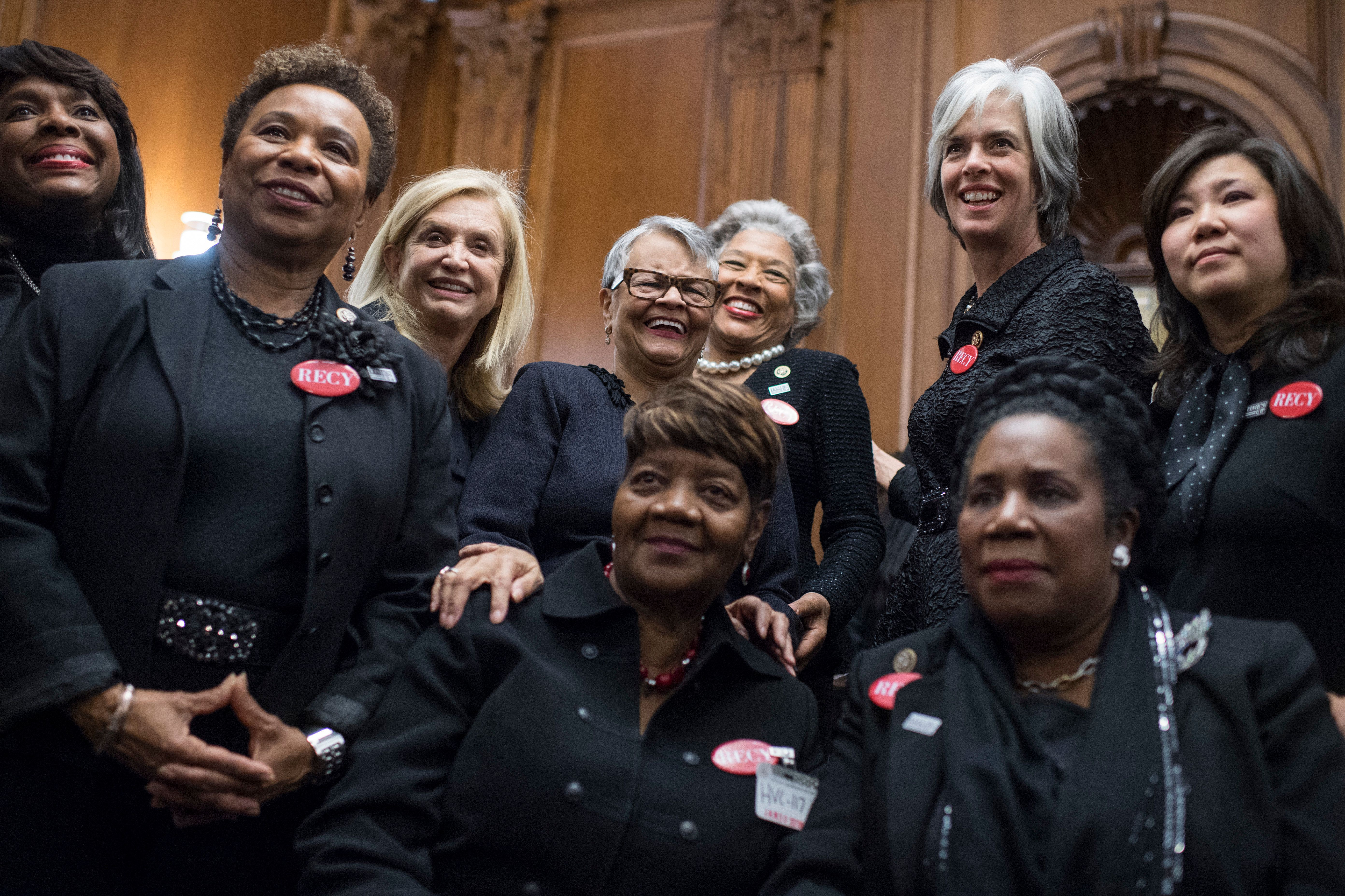 UNITED STATES - JANUARY 30: Rose Gunter, front and center, the niece of sexual assault survivor Recy Taylor, wears black during a photo op in the Capitol's Rayburn Room to show solidarity with men and women who are speaking out against sexual harassment and discrimination on January 30, 2018. Also appearing are, from left, Reps. Terri Sewell, D-Ala., Barbara Lee, D-Calif., Carolyn Maloney, D-N.Y., Bonnie Watson Coleman, D-N.J., Joyce Beatty, D-Ohio, Katherine Clark, D-Mass., Sheila Jackson Lee, D-Texas, and Grace Meng, D-N.Y. (Photo By Tom Williams/CQ Roll Call)