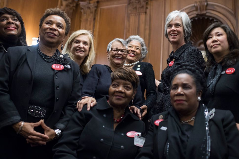 Rose Gunter, center front, the niece of sexual assault survivor Recy Taylor, wears black to show solidarity with the men and