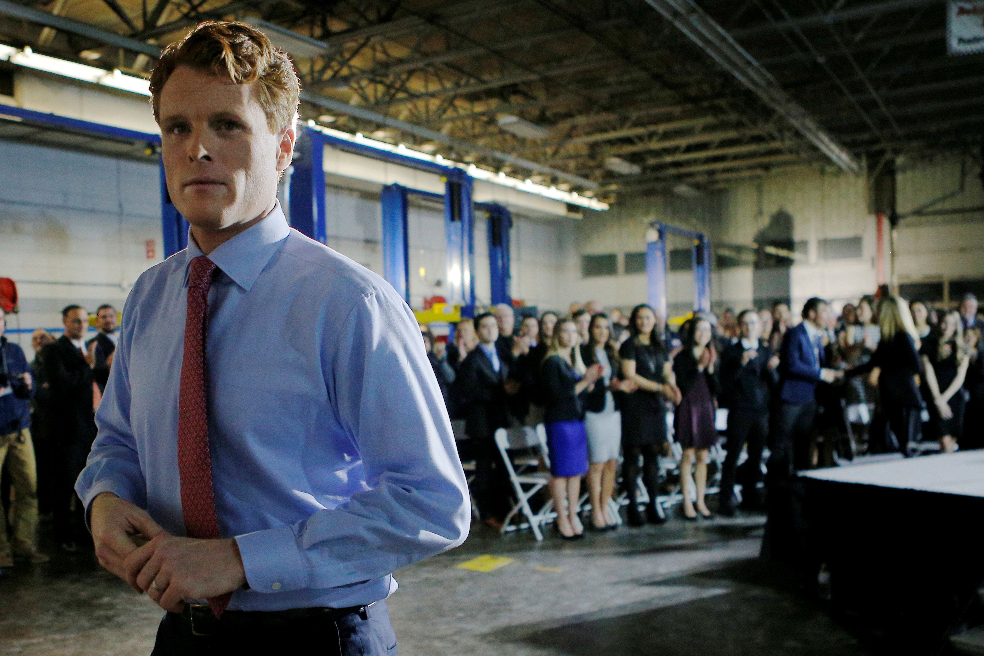 U.S. Rep. Joe Kennedy III (D-MA) leaves the stage after delivering the Democratic rebuttal to U.S. President Donald Trump's State of the Union address in Fall River, Massachusetts, U.S., January 30, 2018.   REUTERS/Brian Snyder