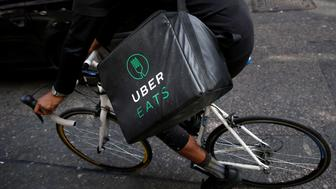 An UberEATS food delivery courier rides his bike in London, Britain September 7, 2016. Picture taken September 7, 2016. To match FOOD-DELIVERY/  REUTERS/Neil Hall
