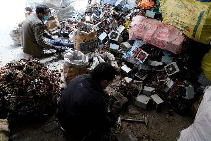 Workers dismantle electronic waste in Guiyu, Guangdong Province, China.