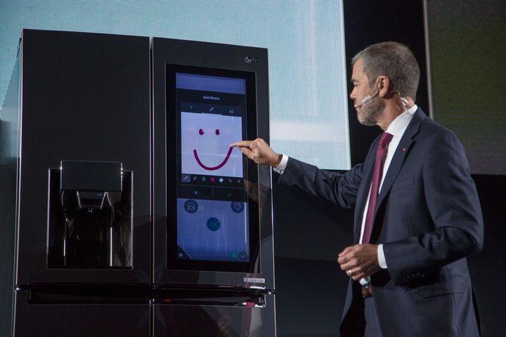 LG Electronics Vice President of Marketing David VanderWaal presenting the LG InstaView smart fridge at the 2017 Consumer Ele