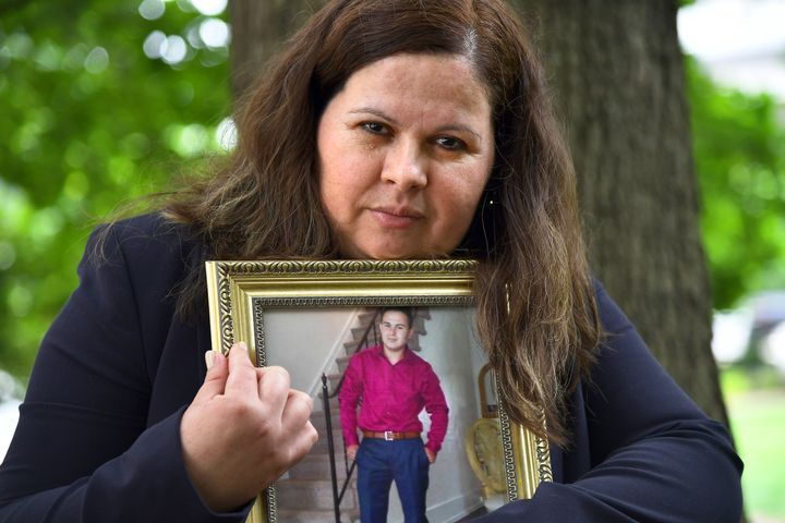 Bertha Morales holds a photograph of her son, Christian Villagran-Morales, who was murdered by members of the MS-13 gang in 2