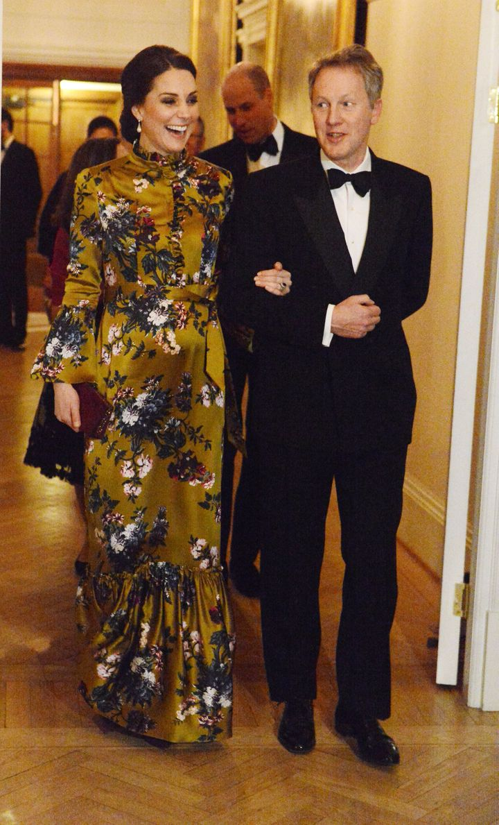 The Duchess of Cambridge is escorted by the British ambassador during a dinner at his residence on Jan. 30.