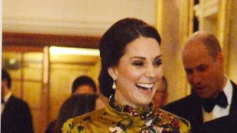 STOCKHOLM, SWEDEN - JANUARY 30:  Catherine, Duchess of Cambridge is escorted by the British Ambassador to Sweden David Cairns at a reception dinner at the British Ambassador's residence during day one of their Royal visit to Sweden and Norway with Prince William, Duke of Cambridge on January 30, 2018 in Stockholm, Sweden.  (Photo by Pool/Samir Hussein/WireImage)