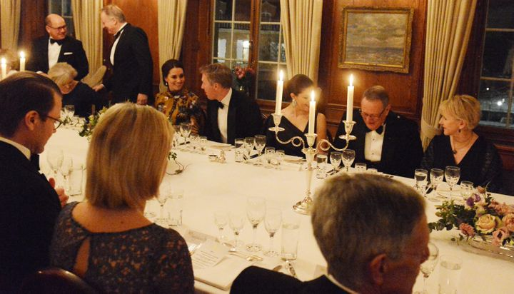 Catherine, Duchess of Cambridge is seated next to the British ambassador to Sweden, David Cairns, during dinner at the ambass