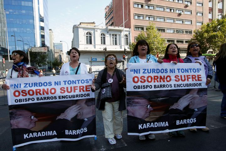 """People hold banners reading """"Neither lefties nor fools, Osorno suffers, Bishop Barros, accessory after the fact,"""" during a protest in Chile on January 16, 2018."""