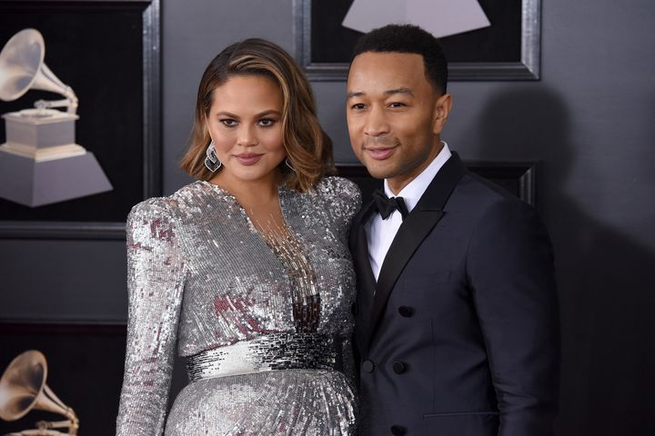 Chrissy Teigen and John Legend stun on the red carpet at the Grammys awards show.