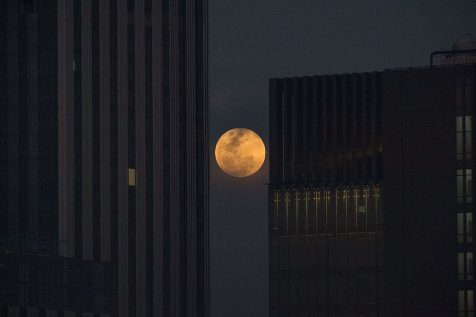 "The ""super blood blue moon"" is seen from Bangkok's cityscape."