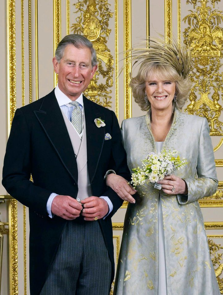 Prince Charles and the Duchess of Cornwall pose for their official wedding photo in the White Drawing Room at Windsor Castle