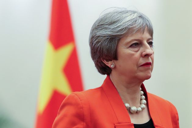 Theresa May is in China on a trade mission while parliament debates Brexit at