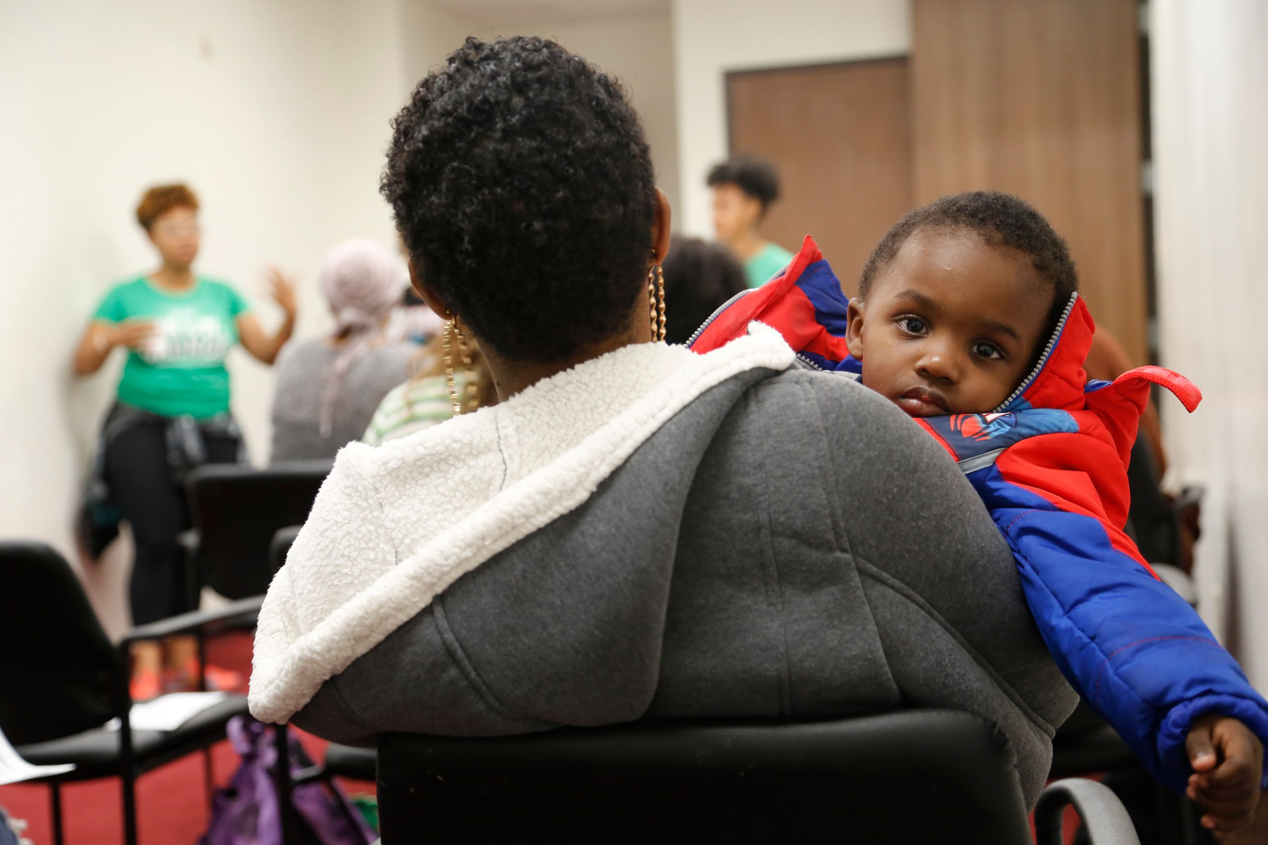 Markiana Richards attends an infant health class at Great Beginnings for Black Babies with her son, Priceton,