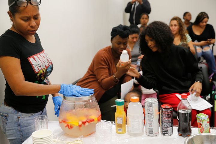 Mylexus Patrick (center) examines the label of a sweet tea bottle to check for sugar during a nutrition exercise at Great Beg