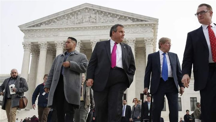 Then-Gov. Chris Christie of New Jersey leaves the U.S. Supreme Court after oral arguments in December on a case that could le