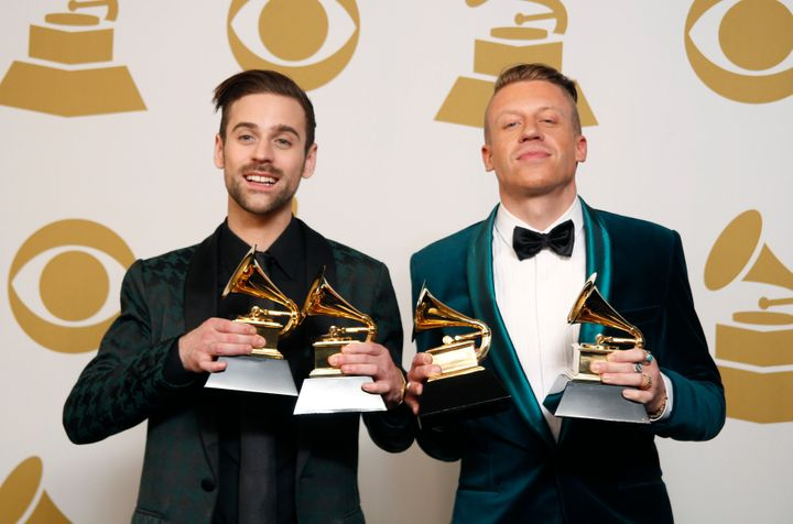 Hip-Hop artists Macklemore (R) and Ryan Lewis pose backstage with their awards.