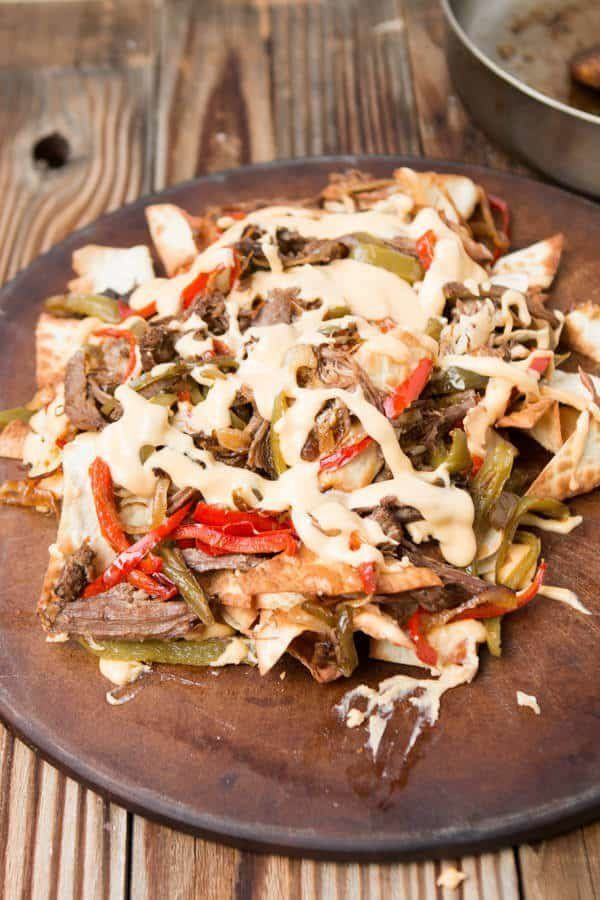 "<strong>Get the <a href=""https://ohsweetbasil.com/philly-cheese-steak-nachos-recipe/"" target=""_blank"">Philly Cheesesteak Nach"