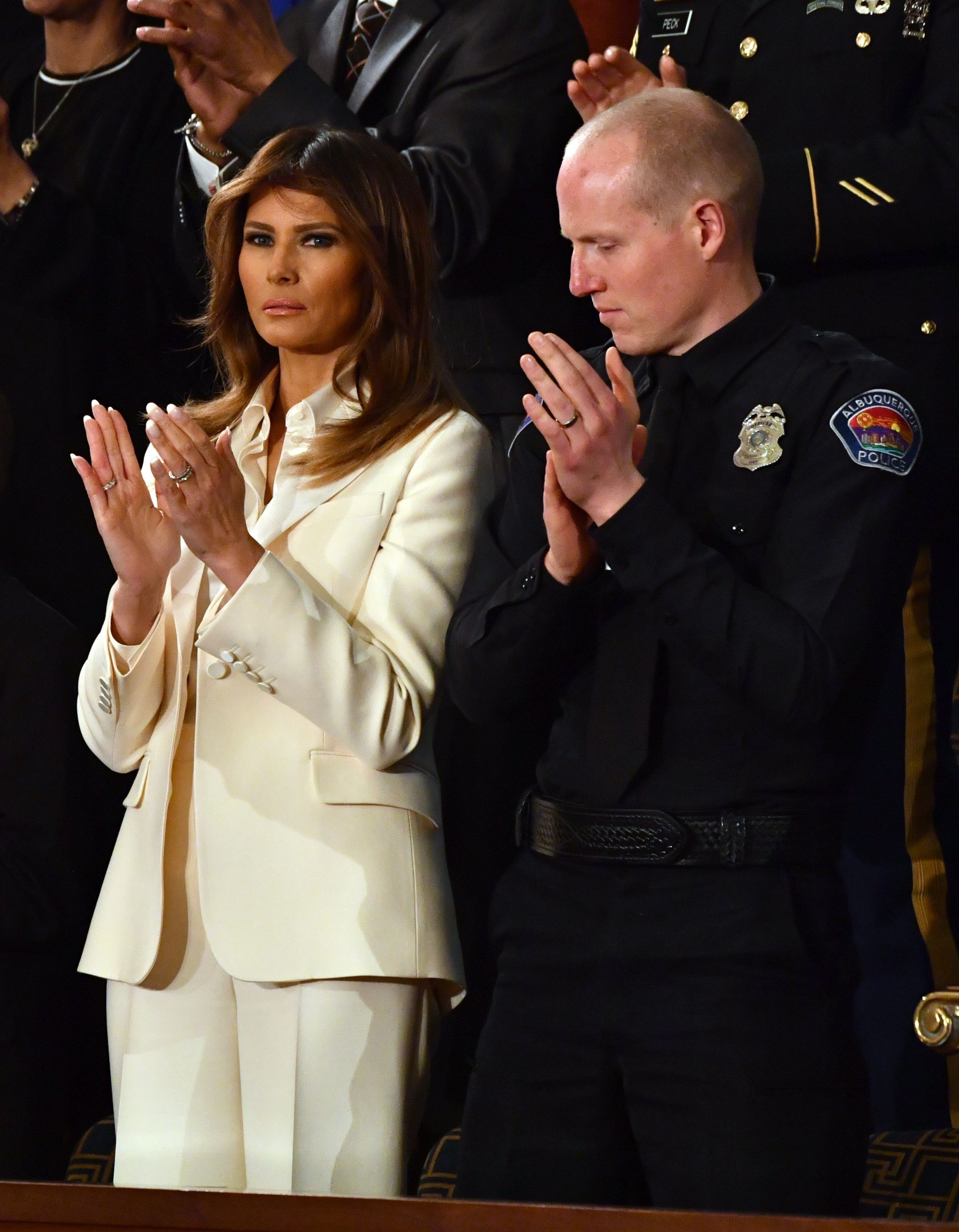 US First Lady Melania Trump and Police Officer Ryan Holets applaud during the State of the Union address at the US Capitol in Washington, DC, on January 30, 2018.  / AFP PHOTO / Nicholas Kamm        (Photo credit should read NICHOLAS KAMM/AFP/Getty Images)